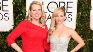 Cheryl Strayed accompanies Reese Witherspoon at the 2015 Golden Globe Awards, a long way from her days on the PCT. (John Shearer / Invision / Associated Press)