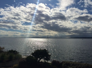 Overlooking the Puget Sound as the sun breaks through the clouds.
